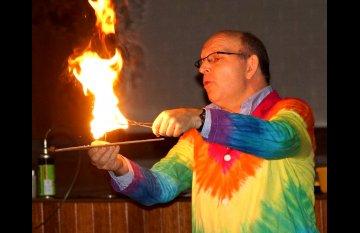 wacky professor doing flame experiment