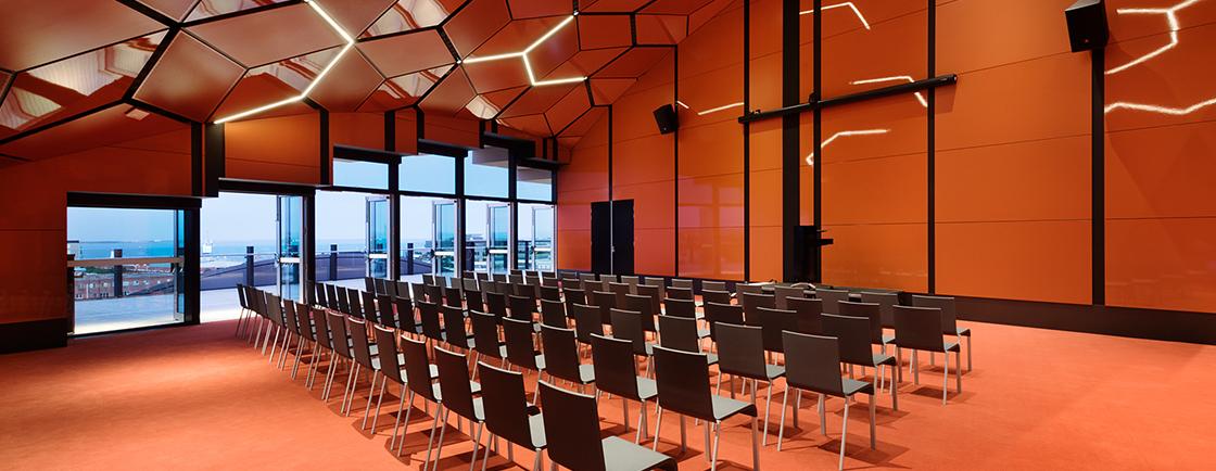 Venue room in The Dome, a bright orange room